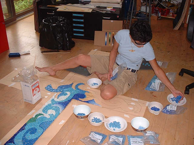 The selection of the glass mosaics become more complex as the work progresses.