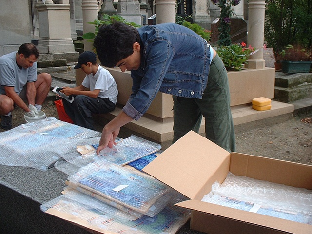 Unpacking the sections of the work for installation in Paris.