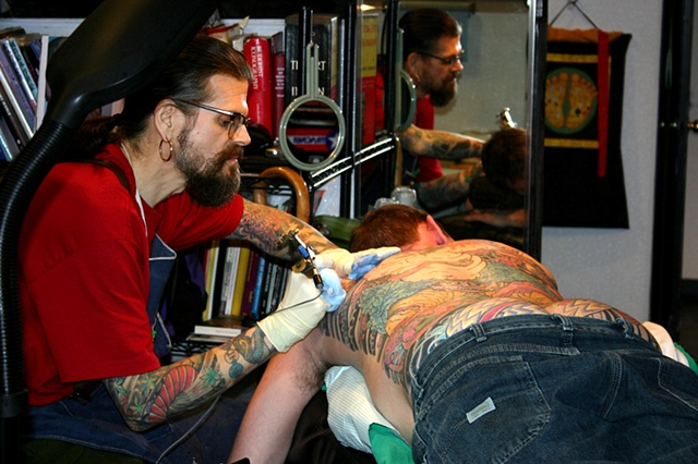D.T. tattooing a killer back piece