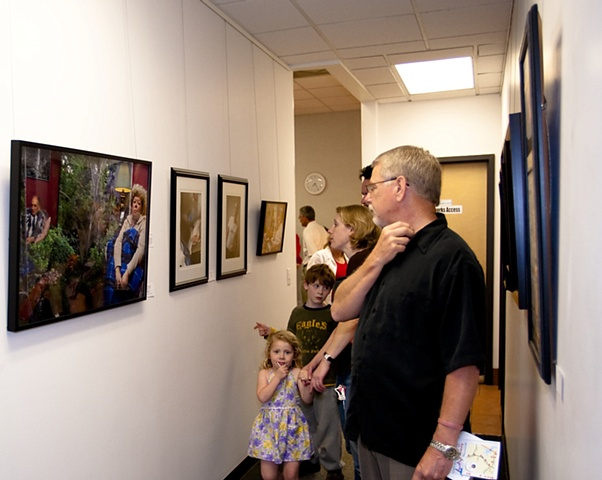 "Spring Show visitors viewing my picture, ""Untitled (Mom and Dad)"""