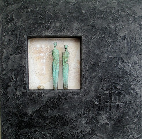 Two Bronze figures with stone