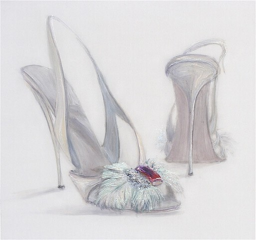 White strappy shoe with mint green feathers and a red rube jewel.
