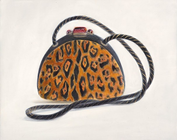 Leopard print purse with gold accents and ruby rhinestone closure.