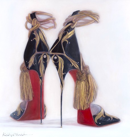 Black shoes with gold leaf design motif with gold tassels and ankle straps. The soles are red.
