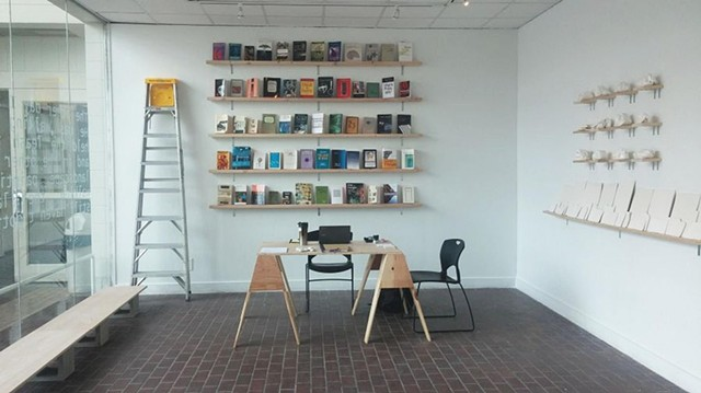 Zone 1 / Conceptualization/Research: Book wall [Resonant source material organized via contiguous association], Service Desk [Open ended station – for reading, contemplation and conversation], Guest Seating, Modular Object Placement