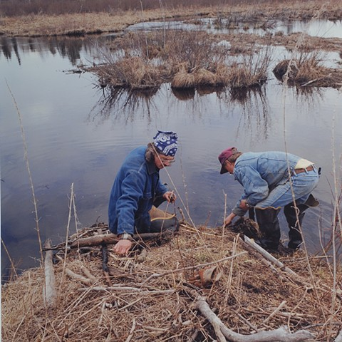 Nick and Ed checking a trap, Lost Creek, near Cusson, Minnesota 1996
