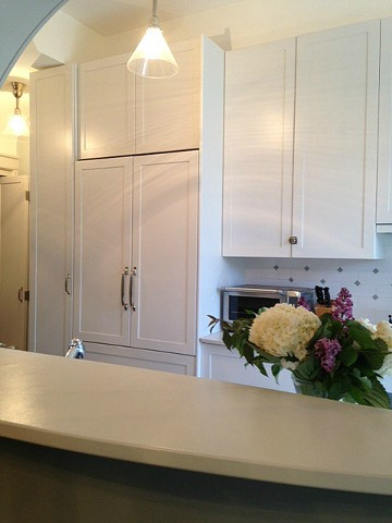 Built in refrigerator, Integrated Refrigerator in Small Kitchen, Brownstone Kitchen by Jane Interiors NYC,  New York Kitchen Designer, Brooklyn Kitchen Designer, Long narrow kitchen with white cabinets, custom kitchen cabinets