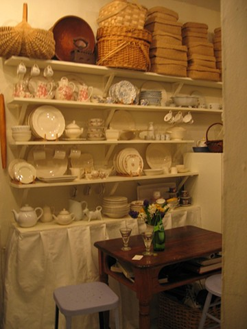 Open shelving is a cost effective solution for storing pretty dishes by Jane Interiors NYC