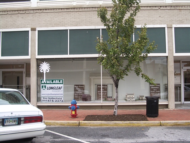 The windows on 100 East Main Street in Spartanburg, SC before the performance
