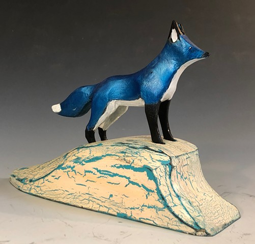 """Blue Fox on Snowbank"""