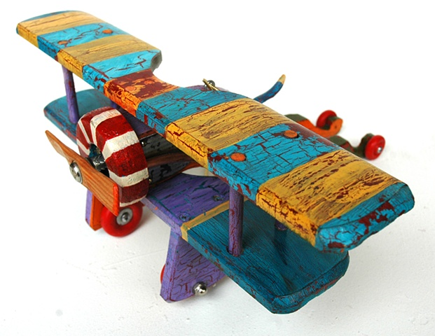 Yellow and Blue Stripped Biplane - SOLD