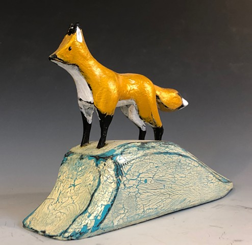 """Gold Fox on Snowbank"""