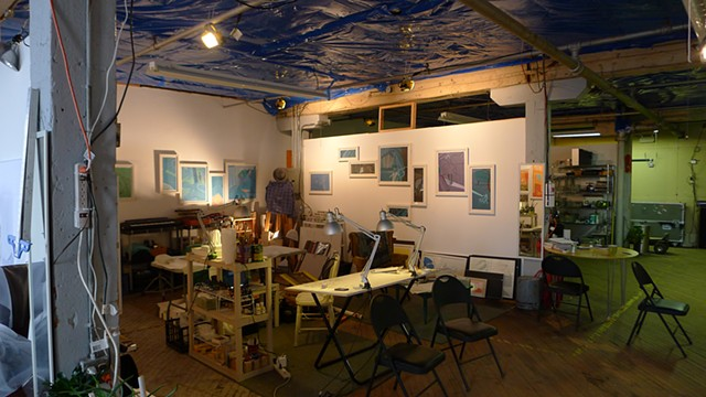 View of artist studio workplace in Chicago with colorful, multi-panel paintings by Steven L. Jones