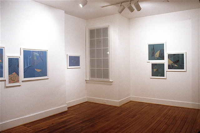 Installation view of gallery exhibit in Richmond, Virginia of colorful, cartoony mutli-panel paintings by Steven L. Jones