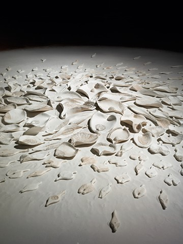 detail of floor installation by Mary Meyer comprised of painted ceramic and sand