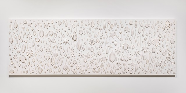 wall panel comprised of porcelain and sewing needles by Mary Meyer