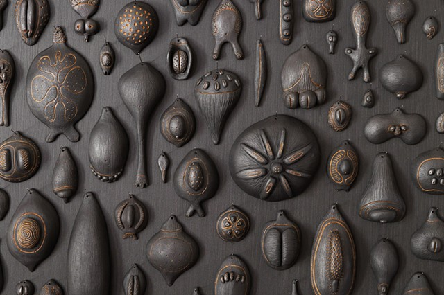 Biophilia (seeds) detail | black clay, graphite, pigment, sewing needles | dimensions vary