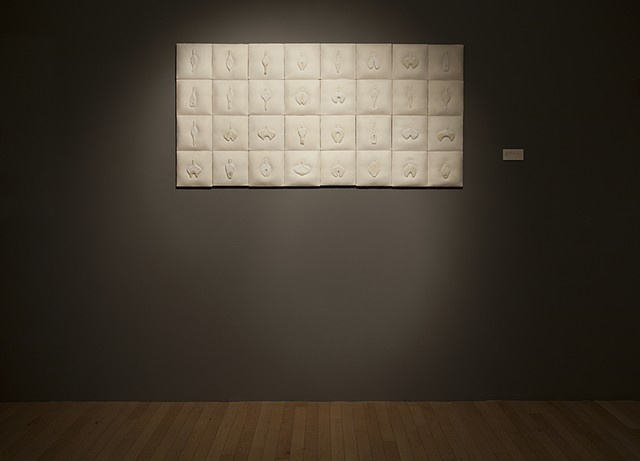mixed media wall installation comprised of painted ceramic on linen with stitching by Mary Meyer