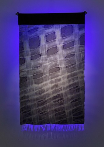 Metamaterial or Tissu/Tissage, gallery installation with blacklight back light