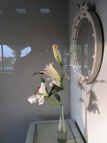 Flowers in entry.  Arches reflected in the glass door.