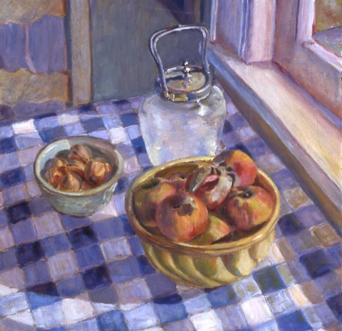 Peaches and walnuts on blue checkered cloth