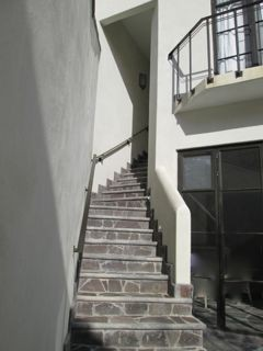 Stairway from second floor to penthouse.  Balcony is in bedroom.
