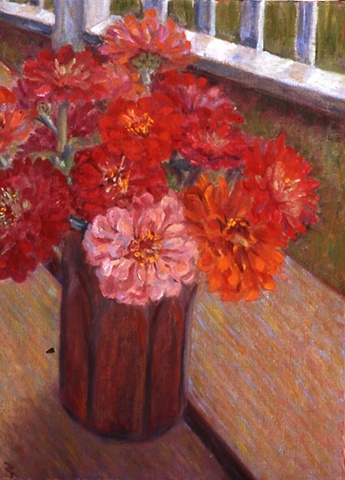 Zinnias in copper vase