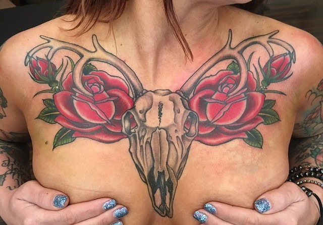 Deer skull with roses chest tattoo