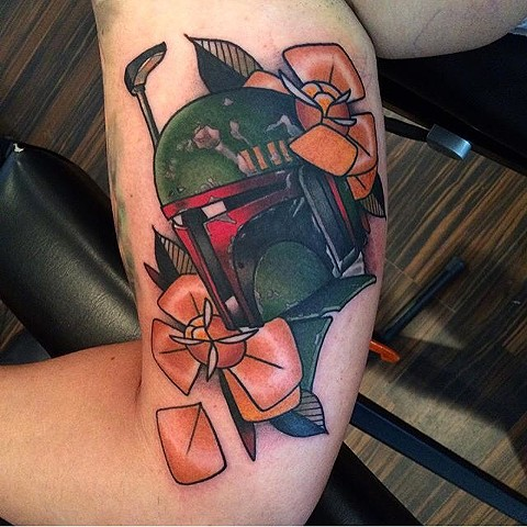 Traditional boba felt tattoo done at classic tattoos by Keller