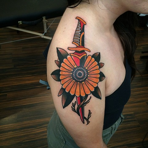 Traditional dagger and sunflower tattoo done at classic tattoos by Keller