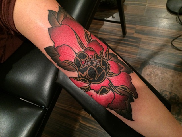 Traditional Peony tattoo done at classic tattoos by keller