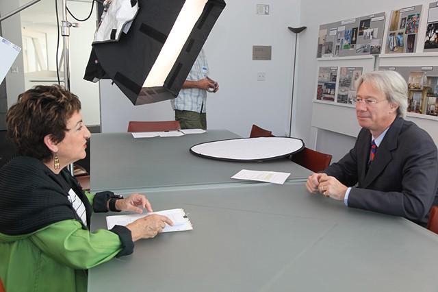 character Lee J. Ross interviews Julian Zugazagoitia in a scene from NV in KC