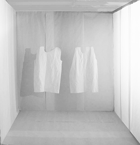 installation of exam room made of paper with floating hospital gowns