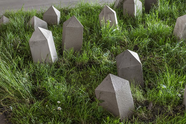 an installation of obelisk points in a field
