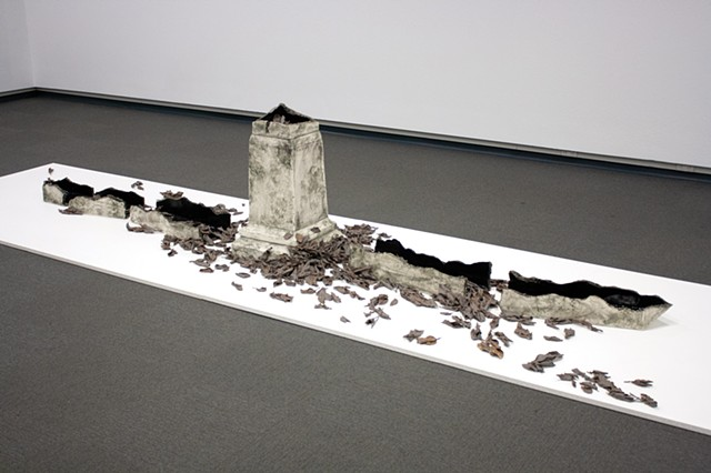 Monument base with fractured and toppled obelisk, with deep black interior glaze. Surrounded by a windfall of blighted apple leaves, dipped in porcelain and burned away.