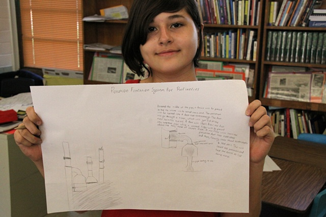 "Baker Middle School student with her drawing for a ""pollution filtration system"" for the nearby refineries, Corpus Christi, Tx."