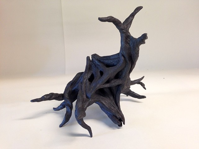 Black stoneware neuron, before adding lights, wires and air dry clay.