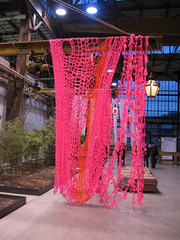 Ribbons and Bows, (detail) 2011. Crocheted and knotted Glo-Pink fluorescent plastic flagging tape and children's barrettes, dimensions variable.