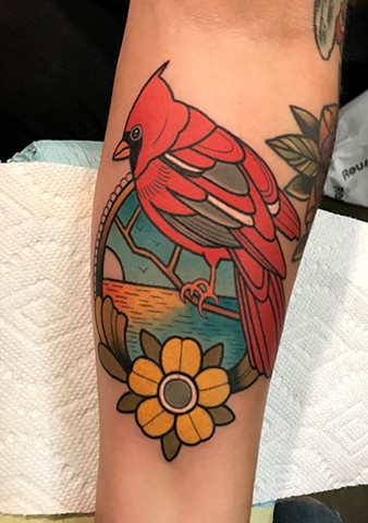cardinal bird tattoo by tattoo artist dave wah at stay humble tattoo company in baltimore maryland the best tattoo shop in baltimore maryland