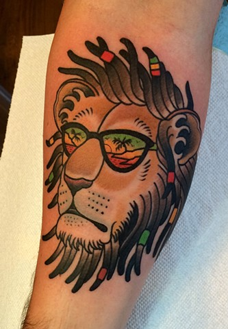 rasta Lion tattoo by dave wah at stay humble tattoo company in baltimore maryland the best tattoo shop in baltimore maryland