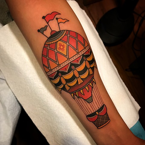 hot air ballon tattoo by dave wah at stay humble tattoo company in baltimore maryland the best tattoo shop and artist in baltimore maryland
