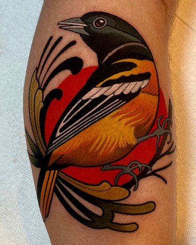 oriole bird tattoo by dave wah at stay humble tattoo company in baltimore maryland the best tattoo shop and artist in baltimore maryland