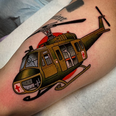 huey helicopter tattoo by tattoo artist dave wah at stay humble tattoo company in baltimore maryland the best tattoo shop in baltimore maryland