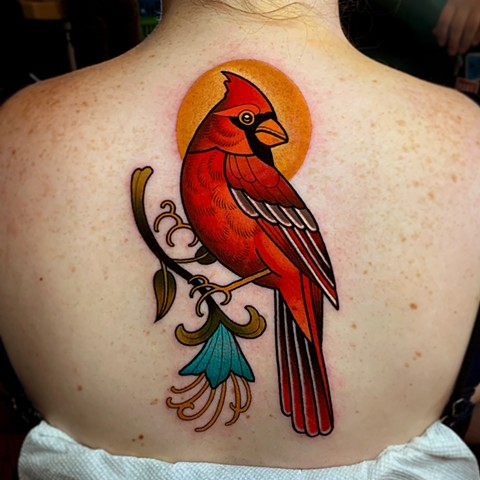 cardinal bird tattoo by dave wah at stay humble tattoo company in baltimore maryland the best tattoo shop and artist in baltimore maryland