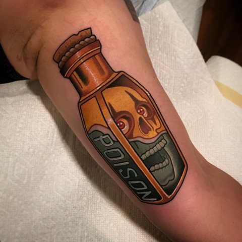 poison bottle tattoo by dave wah at stay humble tattoo company in baltimore maryland the best tattoo shop and artist in baltimore maryland