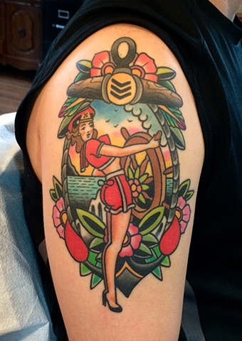 traditional pin up and landscape tattoo by dave wah at stay humble tattoo company in baltimore maryland the best tattoo shop in baltimore maryland