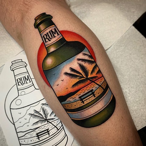 rum bottle tattoo by tattoo artist dave wah at stay humble tattoo company in baltimore maryland the best tattoo shop in baltimore maryland