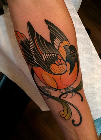 oriole bird tattoo by dave wah at stay humble tattoo company in baltimore maryland the best tattoo shop in baltimore maryland