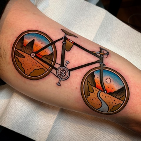 bike and landscape tattoo by dave wah at stay humble tattoo company in baltimore maryland the best tattoo shop and artist in baltimore maryland