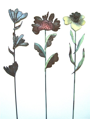 Hand cut steel flowers